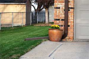 Direct downspouts away from hard-scapes to promote water infiltration.