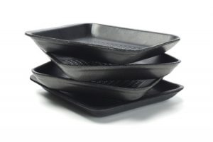 stack of disposable black polystyrene foam trays