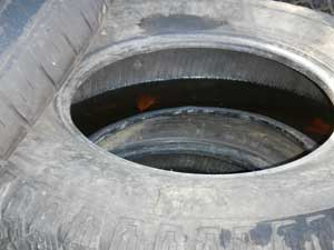 Improperly stored tires create favorable conditions for mosquito breeding.